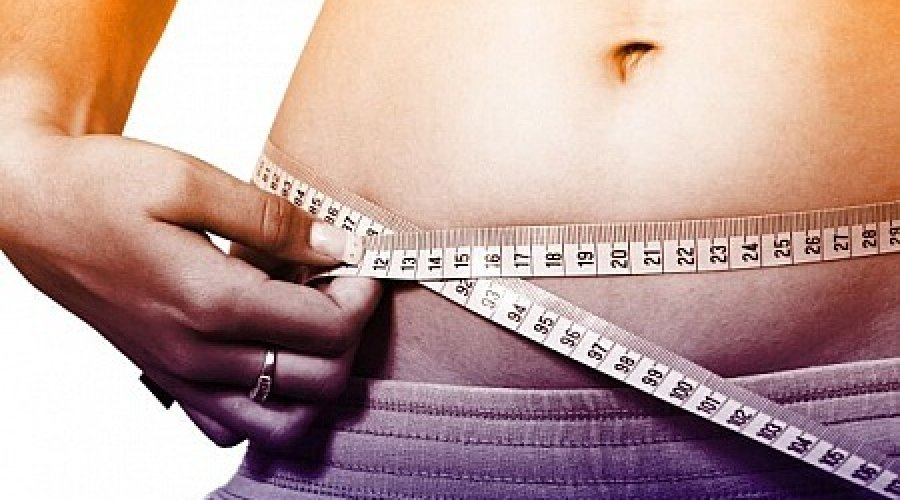 woman-measuring-waistline--how-to-lose-weight-fast